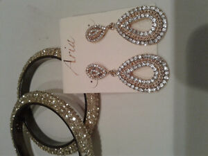 2 bangle style bracelets and matching drop earrings.