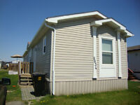 WELL CARED FOR MANUFACTURED HOME IN CREEKSIDE!