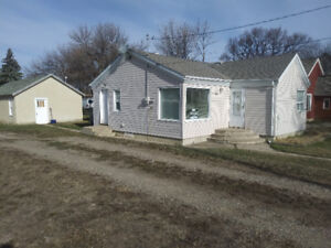 BIG PRICE DROP Revenue property/starter  for sale in Raymond AB