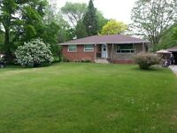 COUNTRY HOME ON 1 ACRE with park like setting