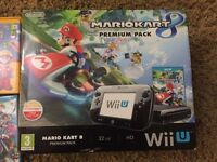 For sale mint and boxed Nintendo Wii U premium pack and 7 games.