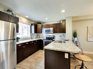 Altius Townhomes in Cy Becker - A Qualico Company