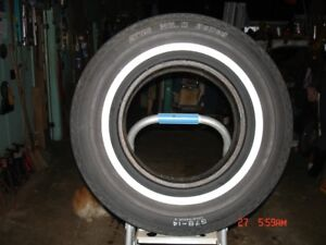 """Old bias ply 14"""" whitewall tires and 64 Impala SS parts"""