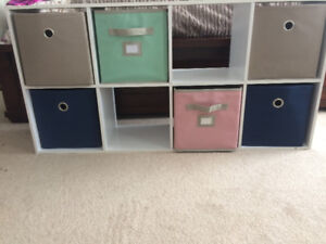 White IKEA storage unit with 6 colored bins