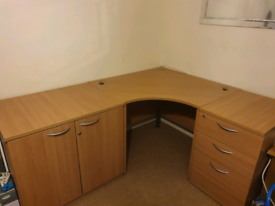 Corner desk with cupboard and draws