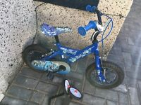 """Childs bike with 12"""" wheels and stabilisers £15 only"""