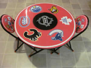 Childrens hockey table 24 inches in diameter,with 2 chairs $32