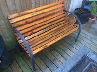 Garden metal bench with wooden slats