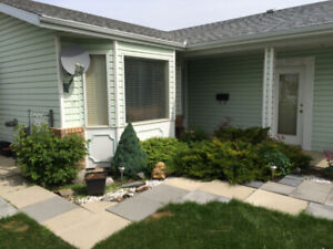 Nice home in Eastview!   Corner lot with trees for privacy.