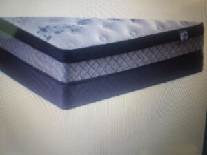 Queen size box spring brand new$40 The Brick