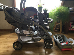 Graco double stroller with attached infant car seat