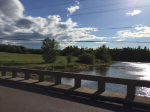 Vacant land 4 acres riverfront in Cocagne NB route 535 for sale
