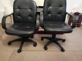 Three leather swivel chairs
