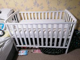White baby cot and mattress
