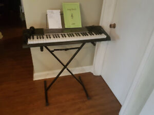 Casio LK-165 Keyboard with Micro Phone Manuel and Song Book