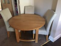 solid oak dining table and 4 suade leather chairs