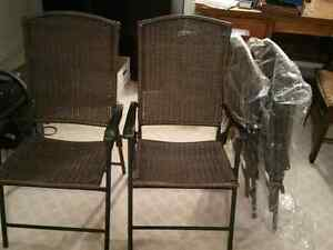 Four new patio chairs never used