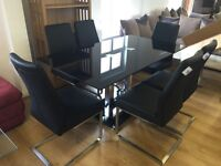 Brand new***High quality glass dining table and leather chairs---BARGAIN AT £500---CALL TODAY!!!