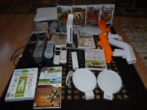 Wii controllers + 11 Games + lots of accessories