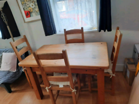 Solid Pine wooden Table and 4 chairs.
