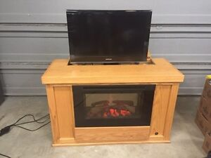 Electric fireplace with automatic pop up TV!