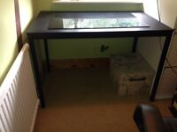 IKEA desk with office chair and glass desk protector