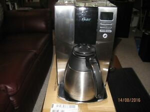 OSTER 10 CUP THERMAL COFFEE MAKER.