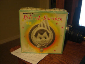 VINTAGE MUSICAL PIXY A SOUNDER/TOYS/ANTIQUE CHRISTMAS ITEMS