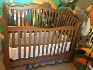 Crib with crib mattress with crib liner and skirt with crib toys