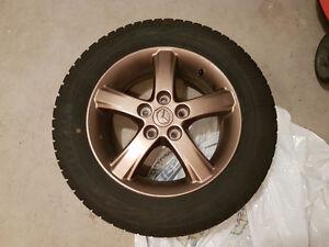 "16"" Bridgestone Blizzak WS80 Winter Tires on Mazda Bronze Rims"