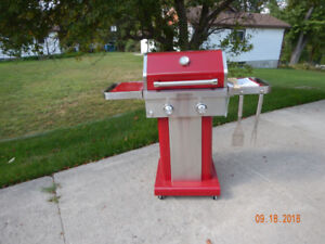 KitchenAid Barbeque (red) with tools and propane tanks