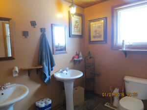 Available immediately! Upstairs room with hardwood floor