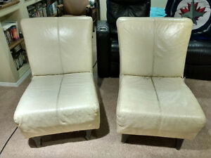 White leather lounge chairs x2