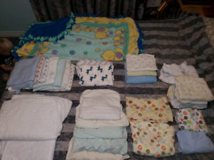 Large lot of baby sheets/blankets