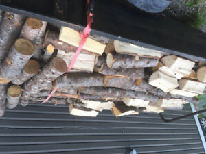 Firewood , mixe. Junked and split . $100 a load.