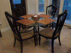 black buffet and table and chairs