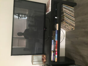 "LG 50"" flat screen television and wood veneer stand"