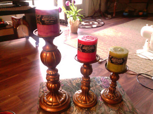 3 pc. Decorative metal candle holders w new scented candles.