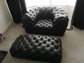 Black Leather armchair and footstool excellent condition