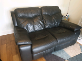 Black leather 2 seater sofa reclines both seats
