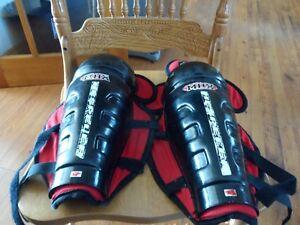 "pair of Hispeler red/black shin pads size 13"""