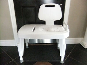new cond shower chair /transfer bench