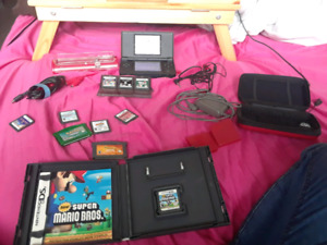 Red Nintendo ds with games