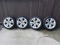 "18""Hyundai Genesis OEM rims with Bridgestone Potenza tires."