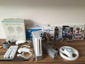 NINTENDO WII BUNDLE WITH MARIO GAMES