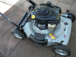 lawnmower  rear bagger ,but no bag  , tuned up .....