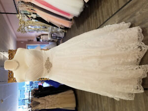 **NEW Price Never worn or altered wedding dress 18-24