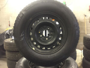 Ford Escape Michelin winter tires on steel rims 225/70/R16