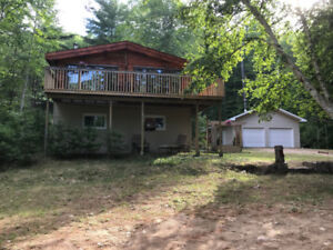 YEAR ROUND CHALET WITH WATERFRONT ON MAZINAW