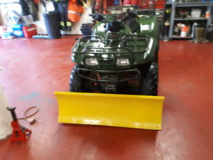 Low kilometer ATV with plow and winch 3600